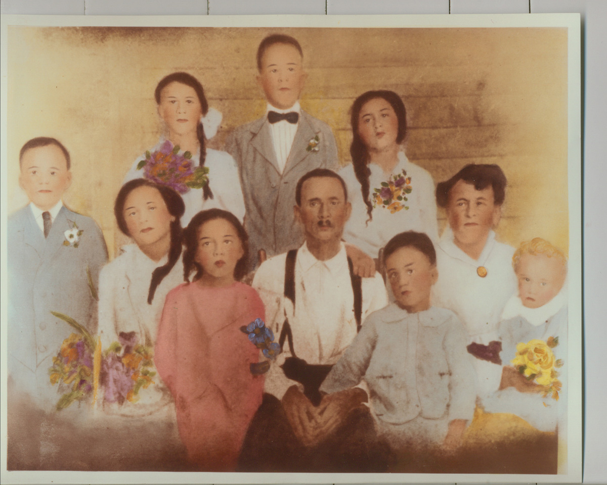 The Johnnie Johnson Family: Back Row l-r: Mattie, Van, Gladys  Front row: Calvin, Linnie, Olivia, Father Johnnie, Welch, Mother Daisy, Adelaide. Ina away at school