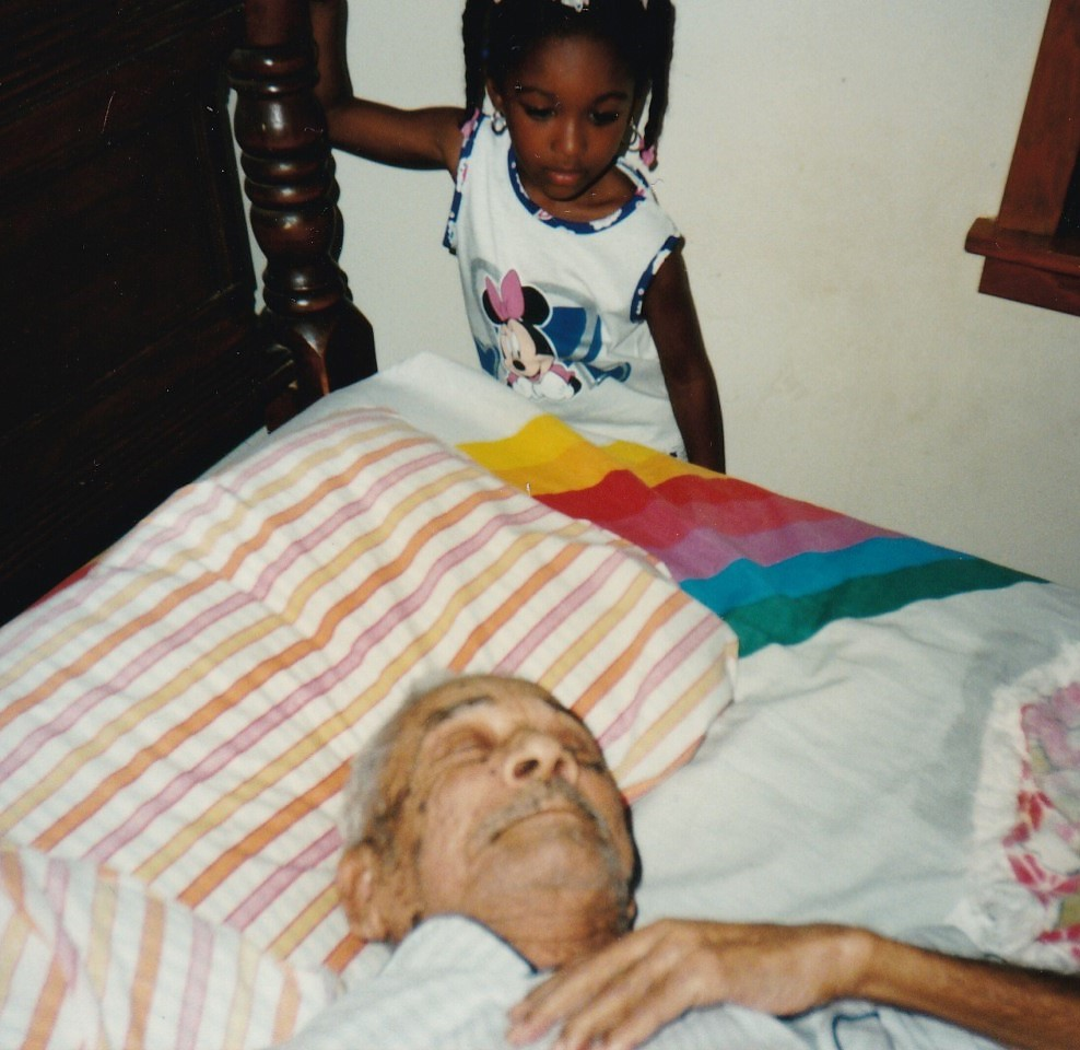 Jack Johnson sleeping while Great Granddauthter Aeriele Johnson is looking at him