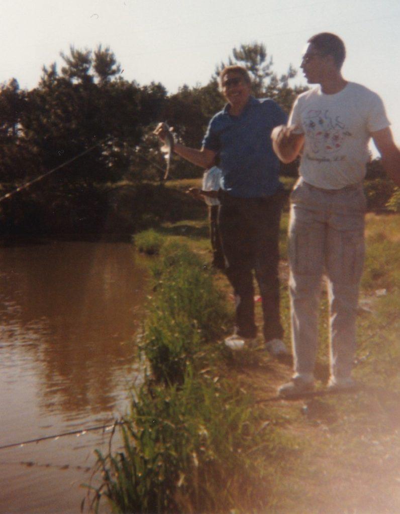 John Lee and son John Jr fishing at family pond