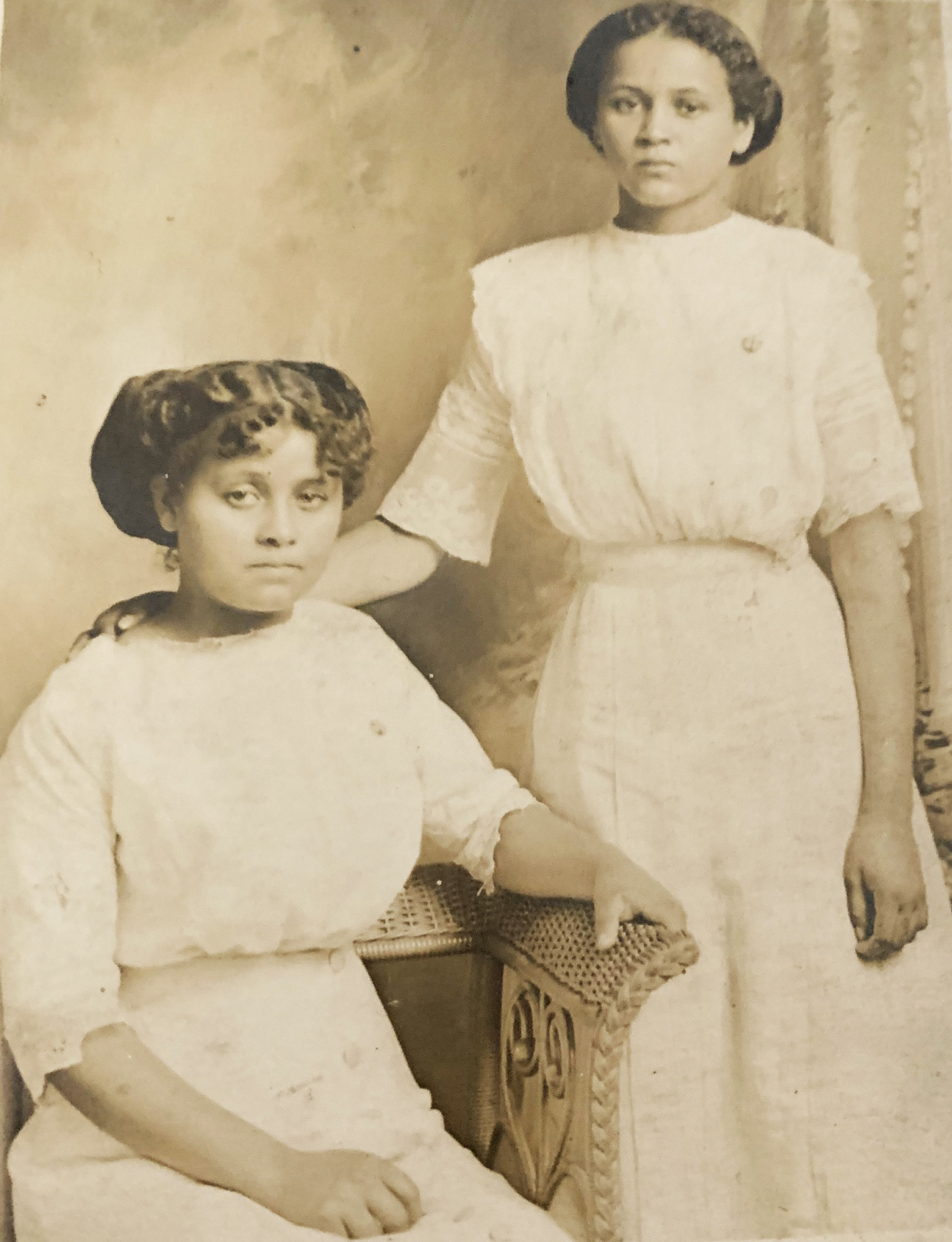 9. Two unknown cousins . Identified as Ina and Linnie OR Colin and daughter.