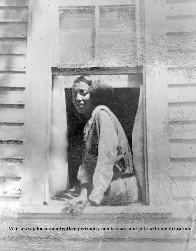 12. Girl in Window